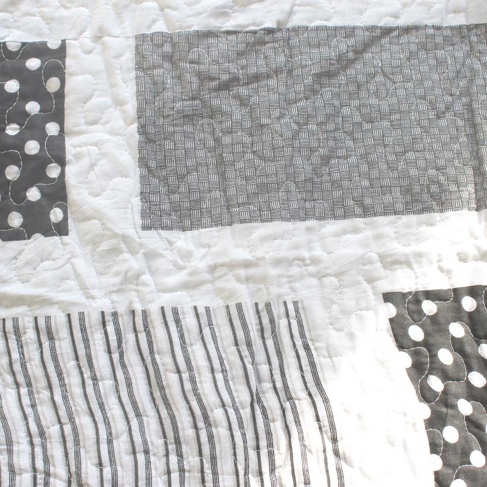 quilt complete squares window triangles and white black